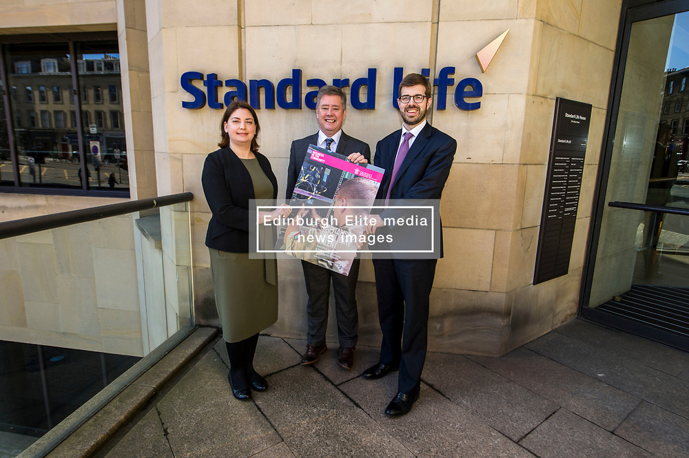 Pictured: Laura Mazarra, Keith Brown and Sandy McDonald, Head of Sustainability at Standard Life Plc; <br /> Veterans minister, Keith Brown MSP visited Standard Life offices in Edinburgh today and launched a toolkit to help firms embrace the skills of veterans and support former military personnel into second careers.  Mr Brown met veteran Laura Mazzara who now works for Standard Life <br /> Ger Harley   EEm 21 March 2017