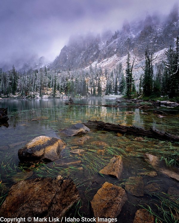 A blanket of fog begins to reveal the mountains at Feather Lakes. Sawtooth Wilderness Area, ID.