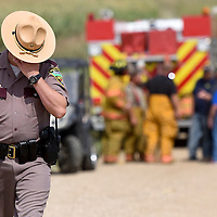Jason Husby with South Dakota Highway Patrol walks away from the wreckage of a plane crash outside of Viborg in Turner County on Friday, Sept. 2, 2016. Sixty-four-year-old Allen Bucholz and 14-year-old Destiny Karpinen were killed in the crash. Both were Tea residents. Bucholz was the pilot, and Karpinen, his granddaughter, was the passenger.