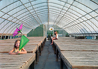 Two Little Girls in an Empty Greenhouse