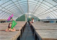 Two Little Girls in an Empty Greenhouse