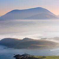 Valentia Island Lighthouse and Begenish Island during misty Sunrise with fisher boat, Ring of Kerry, Ireland / vl105