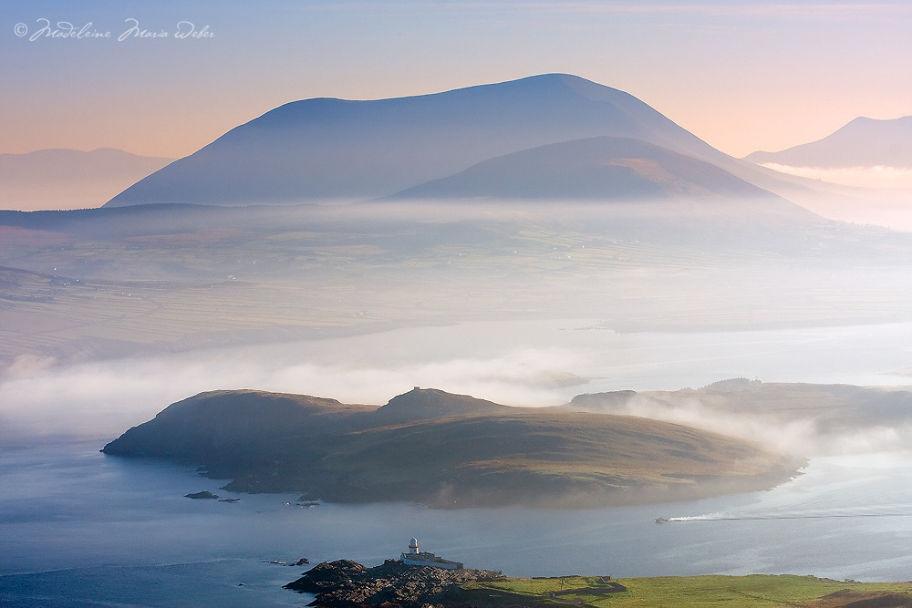 Valentia Island Lighthouse and Begenish Island during misty Sunrise with fisher boat, Ring of Kerry, Ireland / vl105