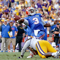 Oct 12, 2013; Baton Rouge, LA, USA; Florida Gators quarterback Tyler Murphy (3) is pressured to throw by LSU Tigers linebacker Grant Leger (53) during the second half of a game at Tiger Stadium. LSU defeated Florida 17-6. Mandatory Credit: Derick E. Hingle-USA TODAY Sports