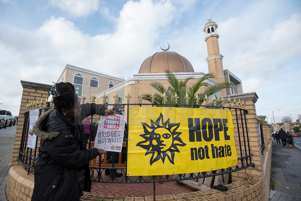 "© Licensed to London News Pictures. 03/02/2017. London, UK. A banner is placed on the railings prior to a human circle of solidarity forming outside Wightman Road mosque in north London during Friday prayers, in an event backed by a coalition of faith groups, including members of Reform Judaism, the Christian Muslim Forum and Faiths Forum for London.  The aim is to ""stand with our Muslim brothers and sisters at this time of international turbulence"", say the organisers. Photo credit : Stephen Chung/LNP"