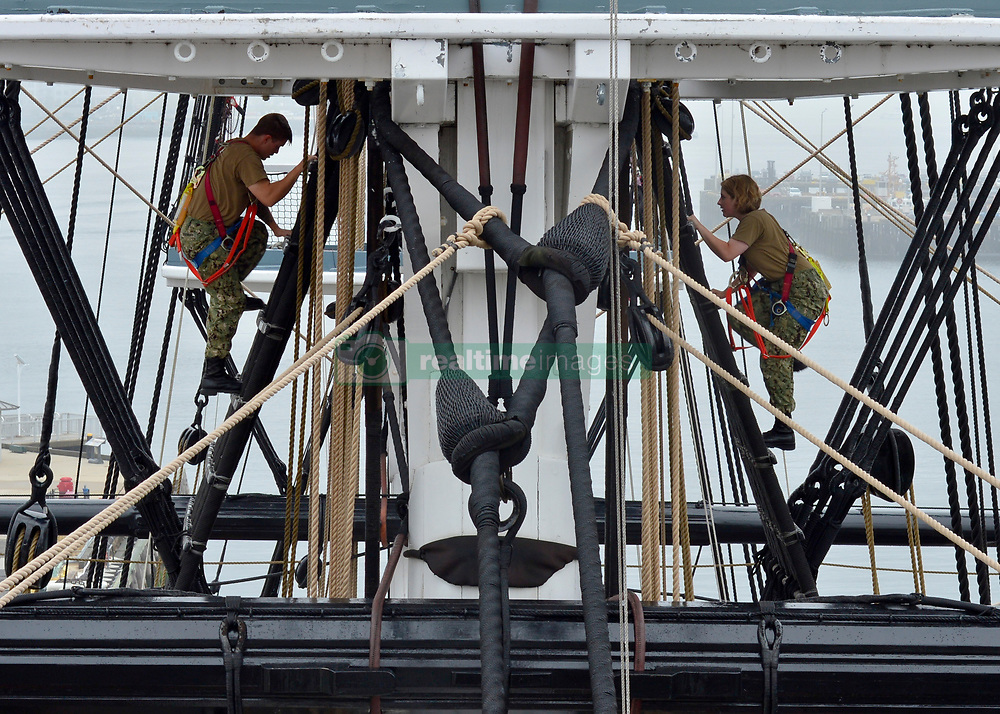 BOSTON (Aug. 13, 2018) Sailors assigned to USS Constitution climb the Main Mast in preparation for the installation of the Topsail 175 feet over the deck of USS Constitution. Constitution's crewmembers conduct weekly training to learn and retain sailing information. (U.S. Navy photo by Mass Communication Specialist 1st Class Joshua Hammond/Released)180813-N-NZ935-0082