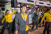 01 OCTOBER 2012 - BANGKOK, THAILAND:   Nok Air employees celebrate the grand reopening of Don Mueang International Airport in Bangkok Monday. Don Mueang International Airport is the smaller of two international airports serving Bangkok, Thailand. Suvarnabhumi Airport, opened in 2006 is the main one. Don Mueang was officially opened as a Royal Thai Air Force base on 27 March 1914 and commercial flights began in 1924. Don Mueang Airport closed in 2006 following the opening of Bangkok's new Suvarnabhumi Airport, and reopened as a domestic terminal for low cost airlines after renovation on 24 March 2007. Closed during the flooding in 2011, Don Mueang was again renovated and reopened in 2012 as the airport for low cost airlines serving both domestic and international passengers. On Monday, Air Asia, Asia's leading low cost airline, transferred all of their flight operations to Don Mueang and the airport was officially reopened. Suvarnabhumi International Airport is already over capacity and Don Mueang's importance as a hub is expected to grow.  PHOTO BY JACK KURTZ