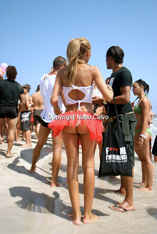 """Sexy attractive young people doing acrobatics as a promotion of Pacha¨•s David Guetta F""""""""ck me Im famous party in Salinas beach, Ibiza, Spain - Photo by Nano Calvo"""