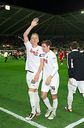 SWANSEA, WALES - Monday, May 15, 2011: Swansea City's Gorka Pintado and Joe Allen celebrate their side's 3-1 victory over Nottingham Forest during the Football League Championship Play-Off Semi-Final 2nd Leg match at the Liberty Stadium. (Photo by David Rawcliffe/Propaganda)