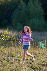 A girl and her butterfly net at the Pell Farm in Grafton, Massachusetts.