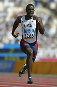 Gold medallist Justin Gatlin wins a first-round heat of the 100 meters in 10.07 in the 2004 Olympics in Athens, Greece on Saturday, August 21, 2004.