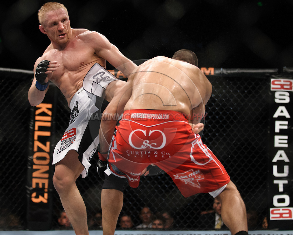 """SYDNEY, AUSTRALIA, FEBRUARY 27, 2011: Dennis Siver (facing) lands a kick to the stomach of George Sotiropoulos during """"UFC 127: Penn vs. Fitch"""" inside Acer Arena in Sydney, Australia on February 27, 2011."""