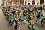 Girls from an Irish dance school parade down Fifth Avenue.