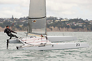 Ray Davies (NZL273) foils to the finish of race one of the A Class World championships regatta being sailed at Takapuna in Auckland. 11/2/2014