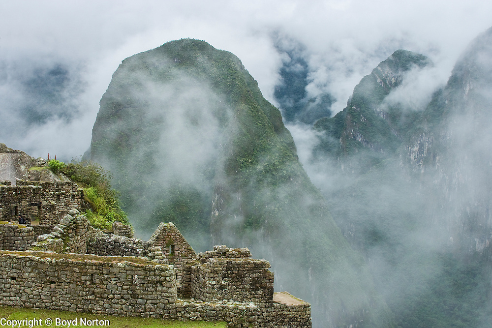 Mist rising over inca ruins of Machu Picchu