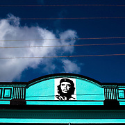 A bright blue building adorned with an image of Ernesto Che Guevara in Baracoa, Cuba on Monday July 14, 2008.