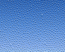 Water condensation formed on glass over a blue background
