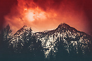Mountain range in winter with a red cloudy sky