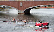 Cambridge. MA. USA. pre 2013 Head of the Charles Publicity for Mini. Red Mini, racing NZL M1X Olympic Medalist Mahe DRYSDALE and Multi Silver Medalist NZL W1X Emma TWIGG on the Charles River in front of the Cambridge Boathouse.<br /> <br /> <br />  Thursday  17/10/2013 <br /> <br /> [Mandatory Credit. Peter Spurrier/Intersport Images]