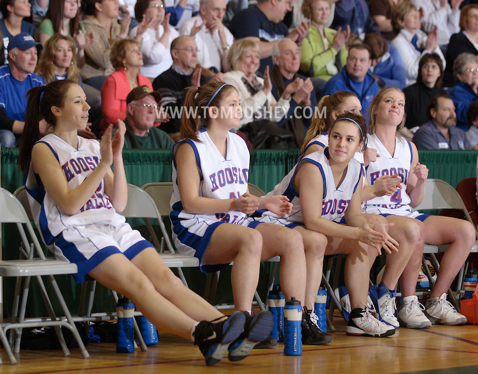 Troy, NY - Hoosic Valley girls' basektball players cheer on the bench at the Class B state semifinals at Hudson Valley Community College on March 14, 2008.