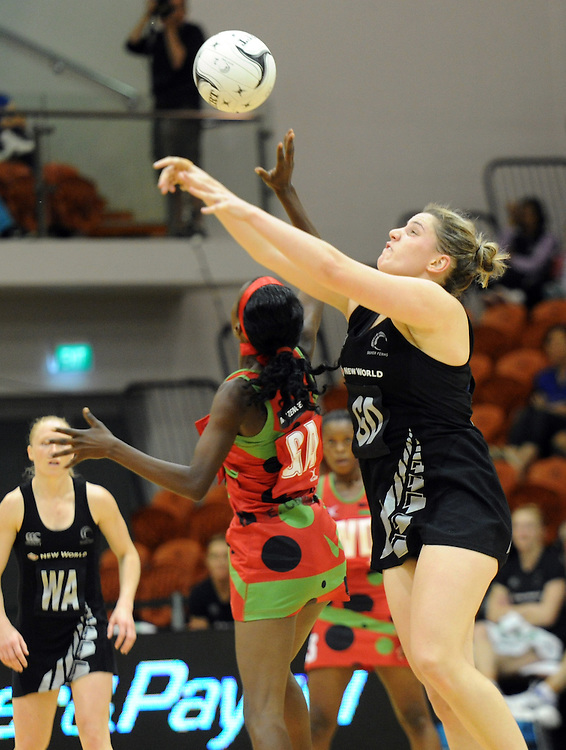 New Zealands' Te Huinga Reo Selby-Rickit, right, contests the ball with Malawis' Jessie Mazengera in the International Netball test at Pettigrew Green Arena, Napier, New Zealand, Sunday, October 27, 2013. Credit:SNPA / Ross Setford