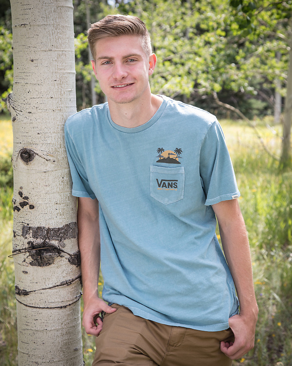 Michael Milisavljevich poses in an aspen grove for his senior portrait.