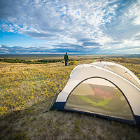camper man with tent on the prairie of montana near ekalaka