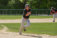 Belmont's Caleb Drouin keeps an eye on the play as he advances to third during Wednesday afternoon baseball with Winnisquam.  (Karen Bobotas/for the Laconia Daily Sun)