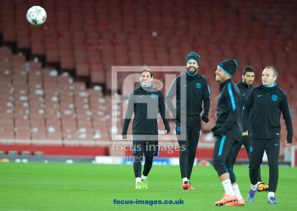 Lionel Messi (left) and Gerard Pique during the Barcelona training session at the Emirates Stadium, prior to their Champions League match against Arsenal tomorrow. London, England.<br /> Picture by Alan Stanford/Focus Images Ltd +44 7915 056117<br /> 22/02/2016