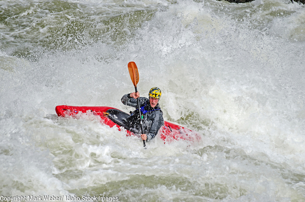 Ryan Casey kayaking the Drop which is rated Class 5 on the Milner Mile section of the Snake River near the town of Murtaugh in southern Idaho