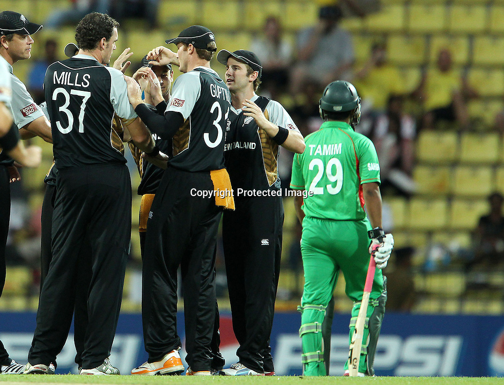 Kyle Mills celebrates the wicket of Tamim Iqbal during the ICC World Twenty20 Pool match between New Zealand and Bangladesh held at the  Pallekele Stadium in Kandy, Sri Lanka on the 21st September 2012<br /> <br /> Photo by Ron Gaunt/SPORTZPICS/PHOTOSPORT