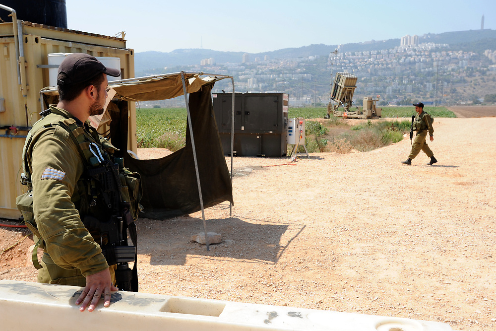 Haifa, Israel - August 30, 2013: Israeli sodiers are seen next to an Iron Dome Anti Missile rockets launcher. As US preparations for attack over Syria are progressing, Israel prepares for possible missile launch from Syria. Photo by Gili Yaari