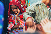 A girl belonging to the Maldhari community standing with other village girls  at a wedding.