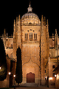 View from the front of South Transept Portal, New Cathedral, Salamanca, Spain, pictured at night, floodlit, on December 17, 2010, with its Cupola and pinnacles above. Salamanca, Spain's most important University city,  has two adjoining Cathedrals, Old and New. The old Romanesque Cathedral was begun in the 12th century, and the new in the 16th century. Its style was designed to be Gothic rather than Renaissance in keeping with its older neighbour, but building continued over several centuries and a Baroque cupola was added in the 18th century. Restoration was necessary after the great Lisbon earthquake, 1755. Picture by Manuel Cohen
