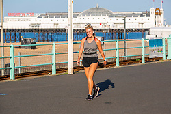 © Licensed to London News Pictures. 31/07/2020. Brighton, UK. Members of the public exercise on the Brighton And Hove promenade as sunny and hot weather already hits the seaside resort early in the morning. Photo credit: Hugo Michiels/LNP