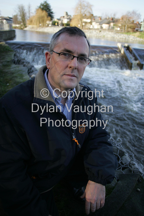 4/1/2004.Local Finna Fail TD John McGuinness pictured at Lacken weir in Kilkenny yesterday showing his concern over the new weir which was built as part of the flood releif scheme in the city and is causing major problems for the salmon trying to get up stream..Picture Dylan Vaughan