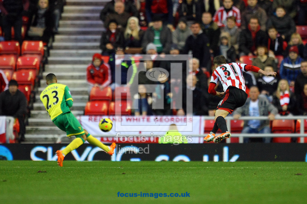 Picture by Paul Chesterton/Focus Images Ltd +44 7904 640267<br /> 21/12/2013<br /> Sunderland's Fabio Borini has a shot on goal during the Barclays Premier League match at the Stadium Of Light, Sunderland.