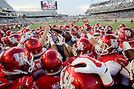 The Houston Cougars team huddle before plying against the Grambling State Tigers on September 6, 2014 at John O'Quinn Field at TDECU Stadium in Houston, TX. (Photo: Thomas B. Shea/For the Chronicle)