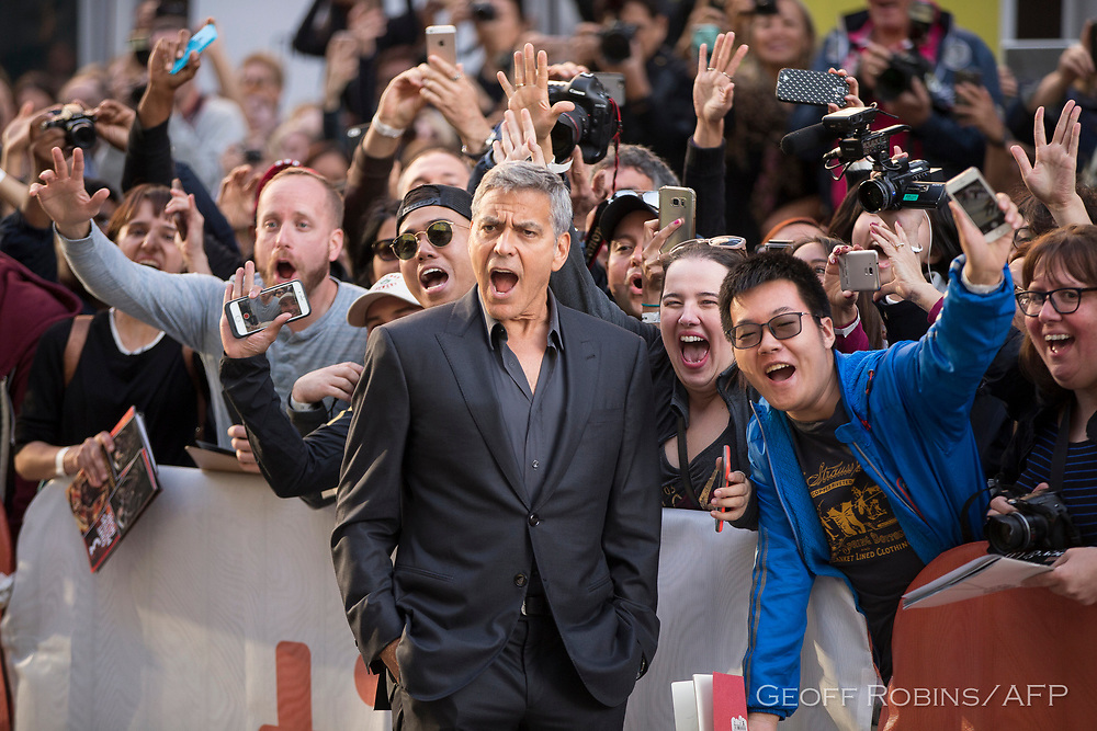 "George Clooney poses with fans at the premiere of ""Suburbicon"" at the Toronto International Film Festival in Toronto, Ontario, September 9, 2017."