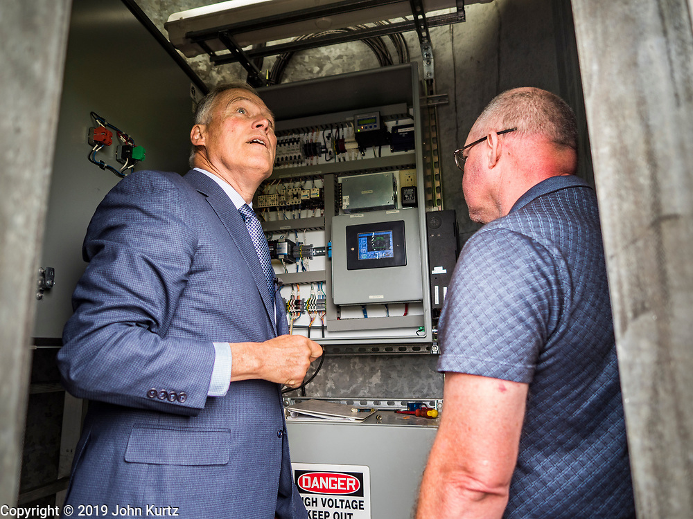 03 JUNE 2019 - ANKENY, IOWA: Governor JAY INSLEE, (D-WA), left, and JAMES FITZPATRICK, a faculty member at DMACC, inside a wind turbine on the DMACC campus. Governor Inslee is running to be the Democratic candidate for the US Presidency in 2020, He has made climate change a central point of his campaign and he toured a wind turbine program at the Des Moines Area Community College (DMACC) in Ankeny. Iowa generates more than 35% of its electrical needs through wind power. Iowa traditionally hosts the the first election event of the presidential election cycle. The Iowa Caucuses will be on Feb. 3, 2020.                        PHOTO BY JACK KURTZ
