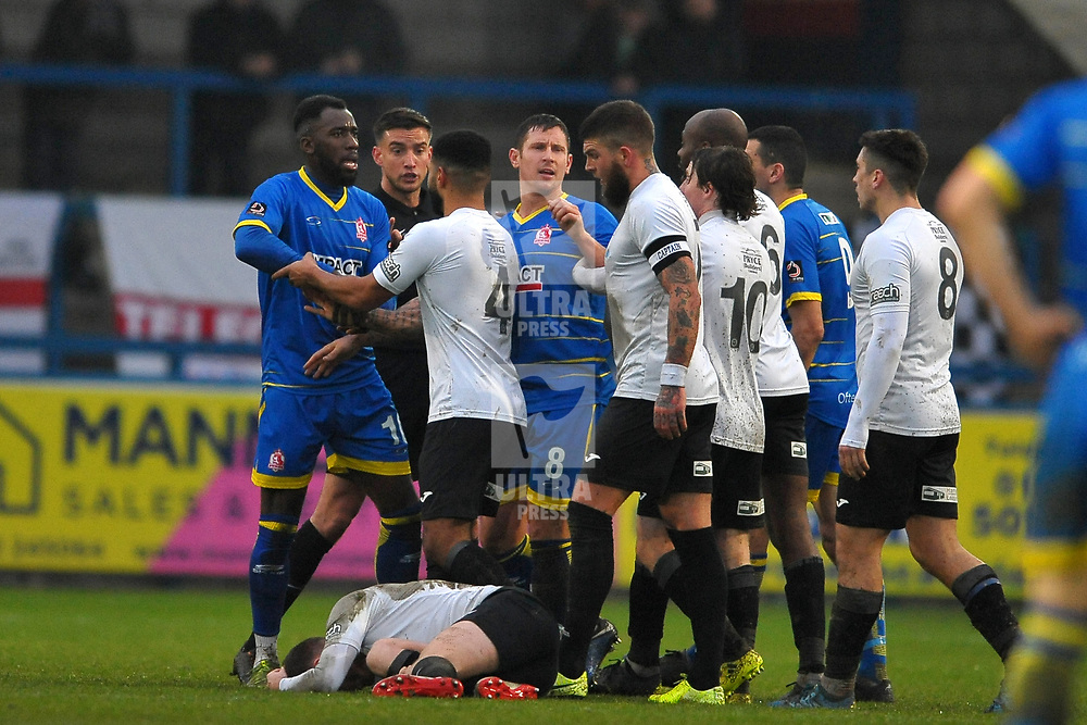 TELFORD COPYRIGHT MIKE SHERIDAN Former telford player Amari Morgan-Smith of Alfreton sparks an angry melee after a late tackle on Arlen Birch of Telford  during the Vanarama Conference North fixture between AFC Telford United and Alfreton Town at the New Bucks Head Stadium on Thursday, December 26, 2019.<br /> <br /> Picture credit: Mike Sheridan/Ultrapress<br /> <br /> MS201920-036