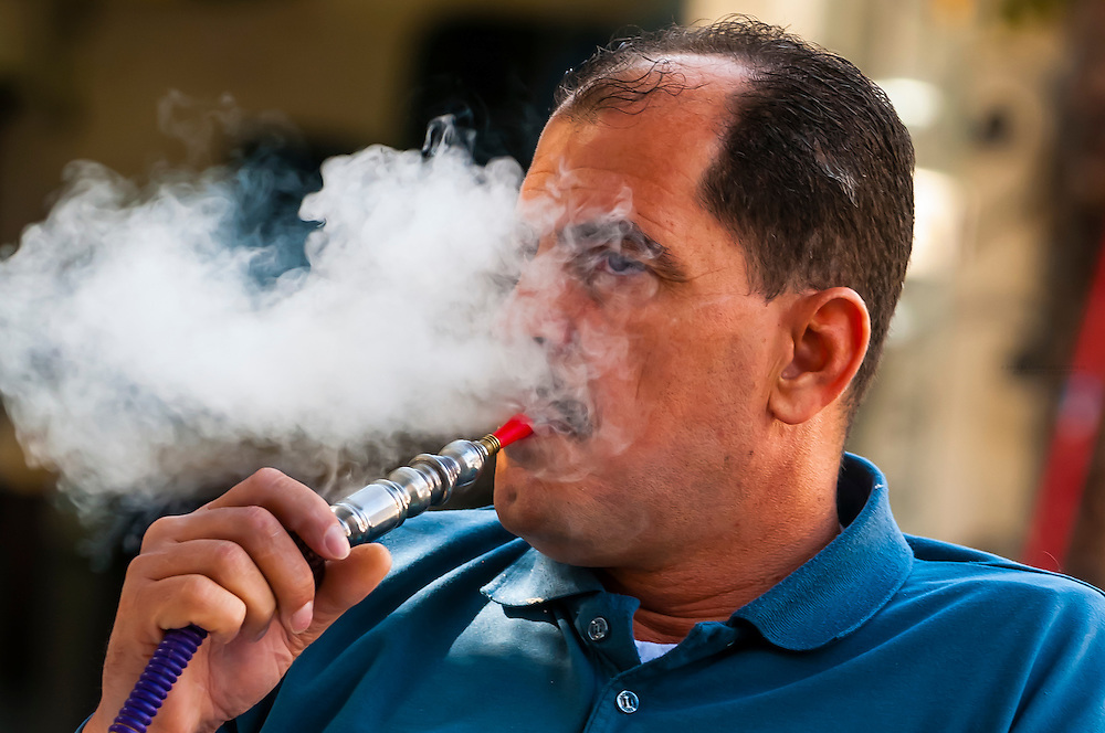 Man smoking a sheesha (water pipe), Aqaba, Jordan