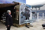 Preparing exhibits at defence, security and aerospace company Thales' exhibition stand at the Farnborough Air Show