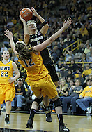 January 28, 2012: Purdue Boilermakers guard Brittany Rayburn (5) is called for a charge as she drives on Iowa Hawkeyes center Morgan Johnson (12) during the NCAA women's basketball game between the Purdue Boilermakers and the Iowa Hawkeyes at Carver-Hawkeye Arena in Iowa City, Iowa on Saturday, January 28, 2012.