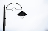 Side view of lamp against sky