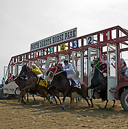 Thoroughbred horses break free from the starting gate during a race at the North Dakota Horse Park in Fargo on Saturday, July 19, 2014.<br /> Nick Wagner / The Forum