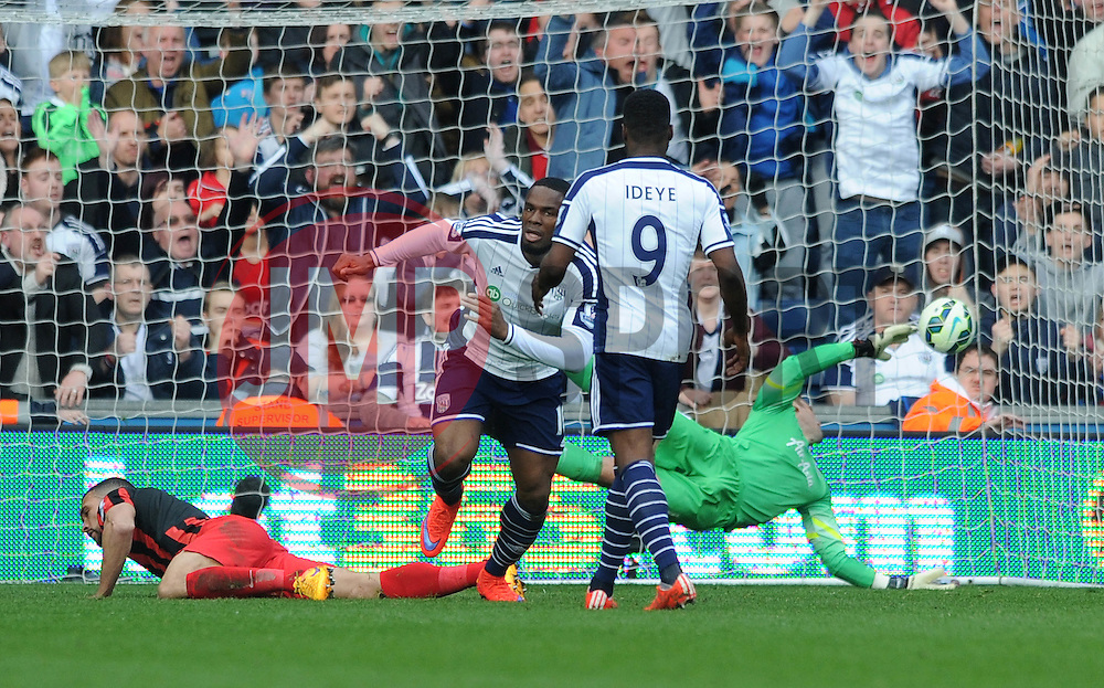 West Bromwich Albion's Victor Anichebe scores and turns to celebrate as Queens Park Rangers' Robert Green attempts to dive for the ball  - Photo mandatory by-line: Dougie Allward/JMP - Mobile: 07966 386802 - 04/04/2015 - SPORT - Football - West Bromwich - The Hawthorns - West Bromwich Albion v QPR - Barclays Premier League