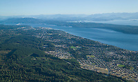 An aerial view of the city of Campbell River, looking towards Quadra Island, the Discovery Islands, and mainland British Coumbia.  Campbell River, Vancouver Island, British Columbia, Canada.