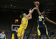 26 JANUARY 2009: Iowa forward Wendy Ausdemore (32) has a shot blocked by Michigan forward Melinda Queen (51) during the first half of an NCAA women's college basketball game Monday, Jan. 26, 2009, at Carver-Hawkeye Arena in Iowa City, Iowa. Iowa defeated Michigan 77-69.