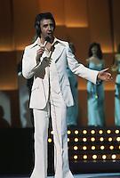 English singer Tony Christie performing, circa 1975.
